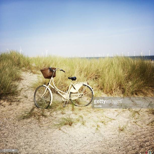 bike parked in the dunes at amager strandpark - denmark stock pictures, royalty-free photos & images