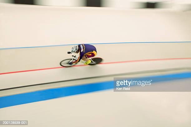 Bike racer on track, (blurred motion)