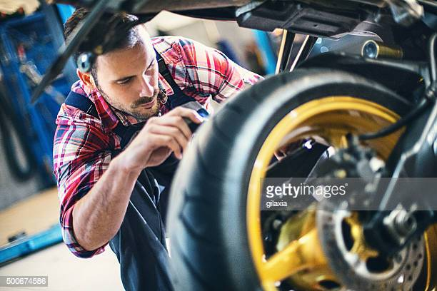 bike repair. - motorbike stock photos and pictures