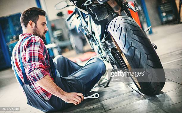 bike repair. - motorcycle stock pictures, royalty-free photos & images