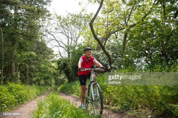 bike ride enjoying nature - morpeth stock pictures, royalty-free photos & images
