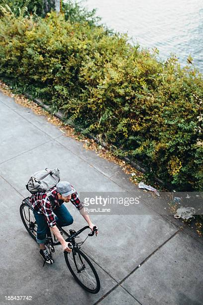 bike rider overhead - willamette river stock photos and pictures
