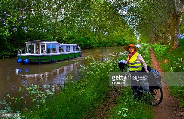 Bike rider stops at the Canal du Midi