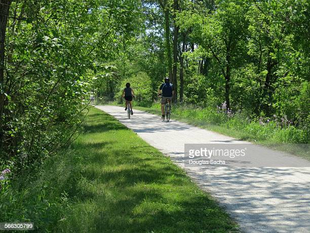 Bike riders enter the wooded forest