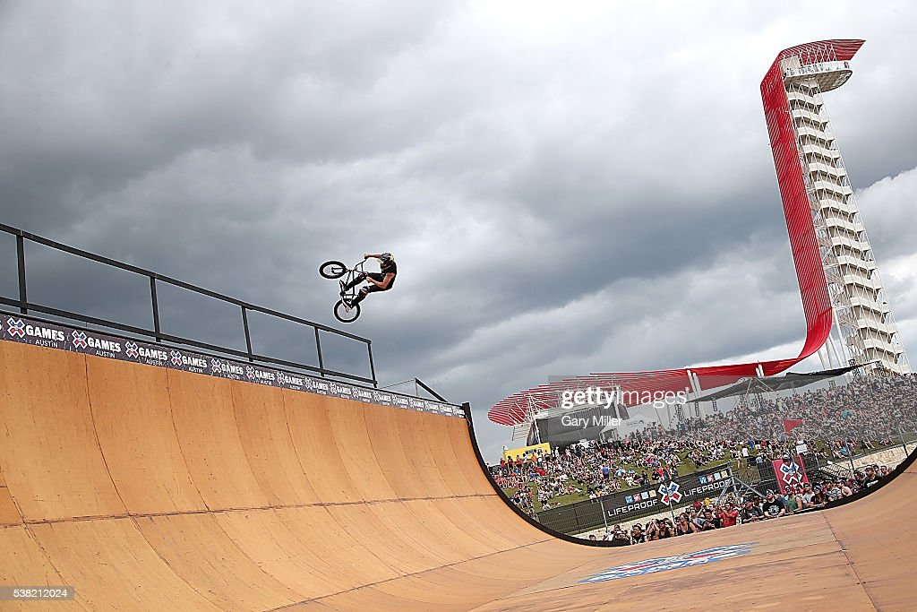 BMX bike riders practice on the vert ramp during the X Games at