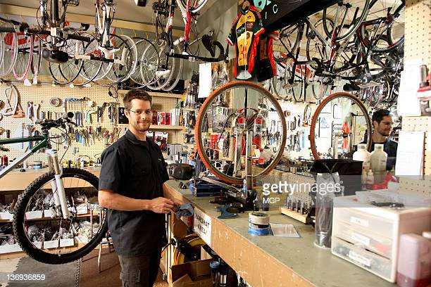Bike shop owner poses