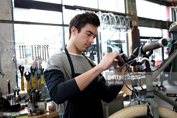 bike shop - adjusting stock pictures, royalty-free photos & images