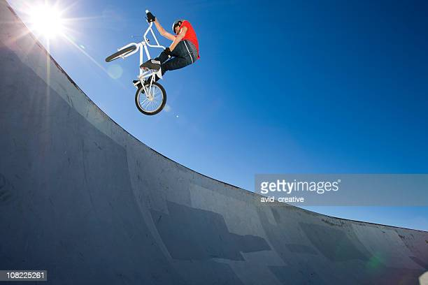 bmx bike stunt at skateboard park - bmx cycling stock pictures, royalty-free photos & images