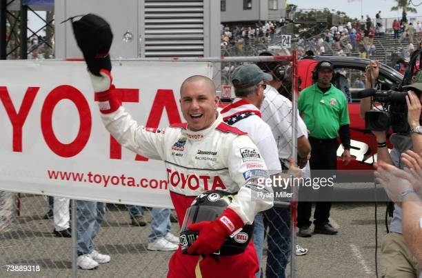 Bike Stunt Rider Dave Mirra celebrates in the victory circle after winning the 31st Annual Toyota Pro/Celebrity Race at the Toyota Grand Prix of Long...