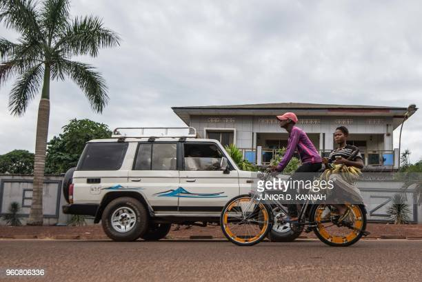 A bike taxi carries a woman on May 20 2018 on Bonsomi avenue in Mbandaka northwest of DR Congo as 45 cases of Ebola virus has been recorded in the...