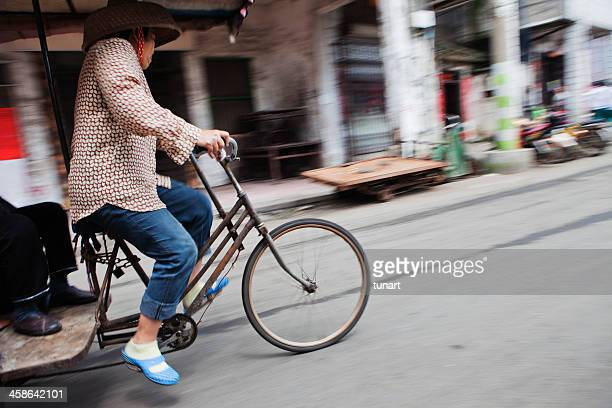 bike taxi in haikou, china - haikou stock pictures, royalty-free photos & images