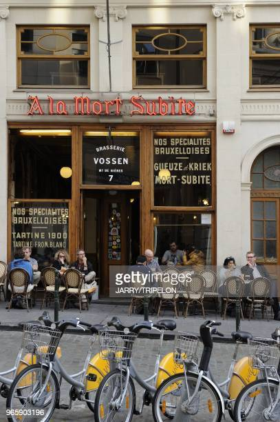 Bike to rent and A La Mort Subite bar on Montagne aux Herbes street district centre called the Pentagon city of Brussels BrusselsCapital Region...