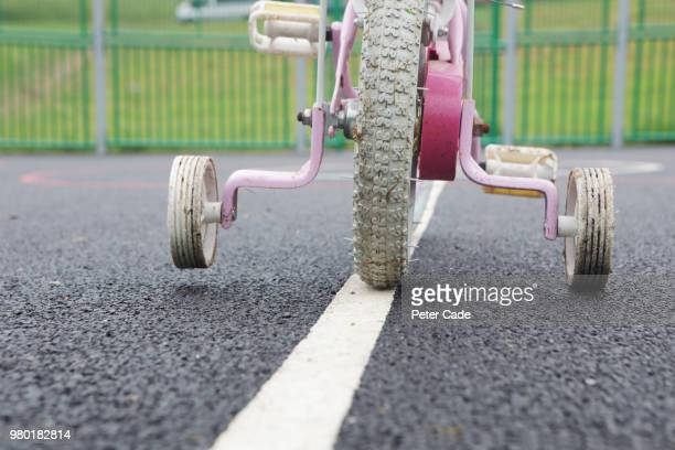 bike wheels with stabilizers - stability stock pictures, royalty-free photos & images
