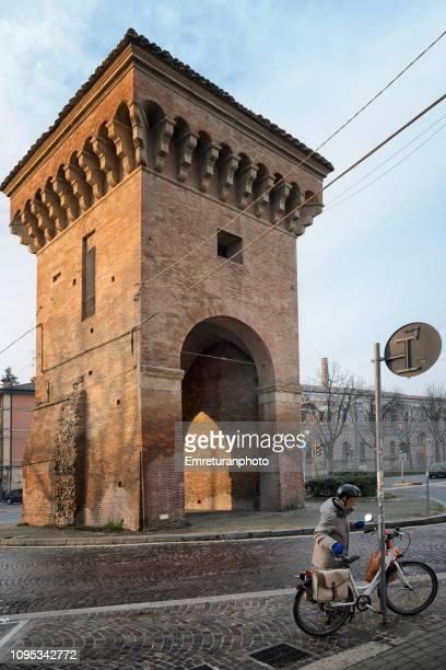 a biker and tower of castiglione early in the morning. - emreturanphoto bildbanksfoton och bilder