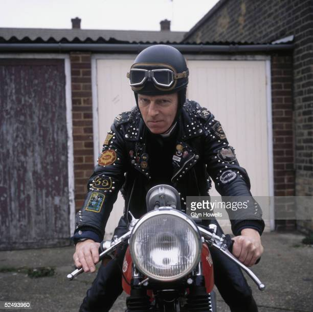 A biker astride his Triumph motorcycle circa 1990