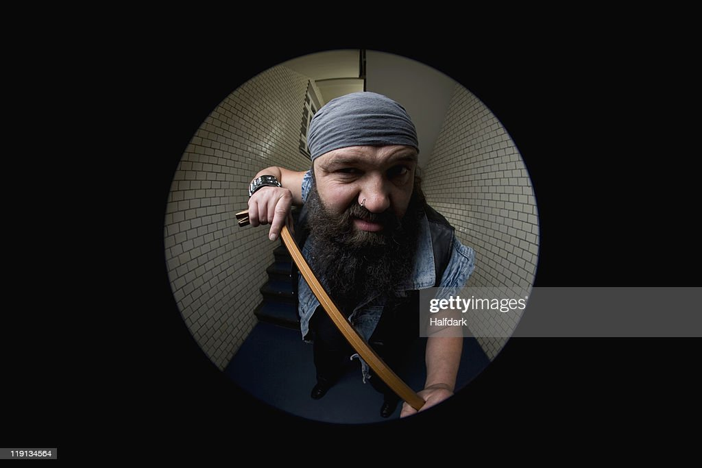 A Biker Breaking Into A Door With A Crowbar Viewed Through A Peephole Stock  Photo | Getty Images