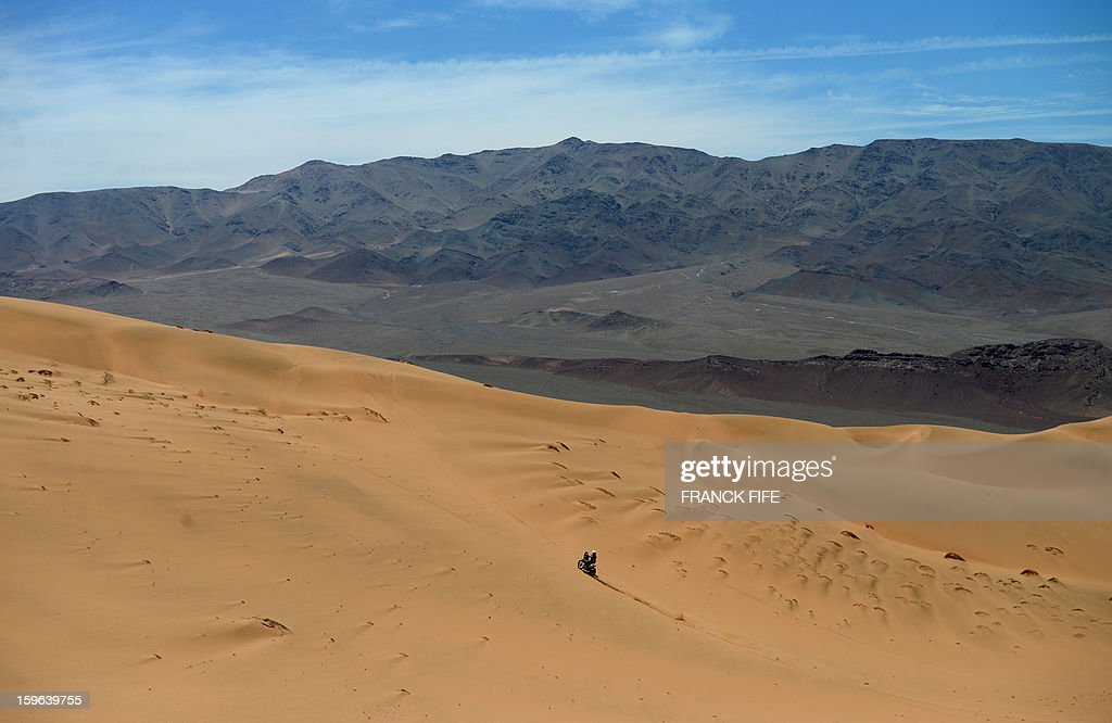 A biker competes during the Stage 12 of the Dakar 2013 between Fiambala, Argentina and Copiapo, Chile, on January 17, 2013. The rally takes place in Peru, Argentina and Chile between January 5 and 20.