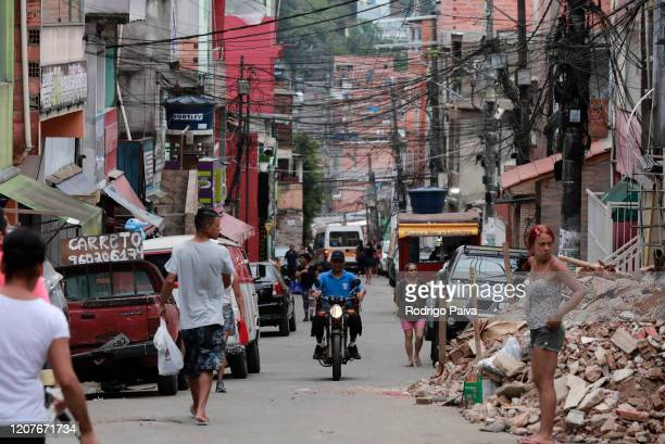 A biker crosses through a street at the Paraisopolis favela on March 19 2020 in Sao Paulo Brazil Paraisopolis is the second largest favela in the...