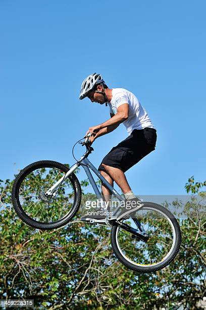 bmx biker demonstrating his skills - johnfscott stock pictures, royalty-free photos & images