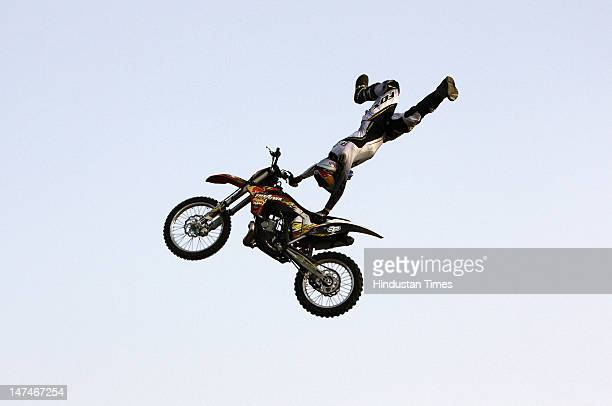 A biker does a stunt during Red Bull XFighters Freestyle Motocross motorbike stunt competition on June 30 2012 in New Delhi India