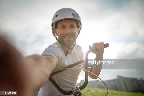 bmx biker doing selfie - control stock photos and pictures