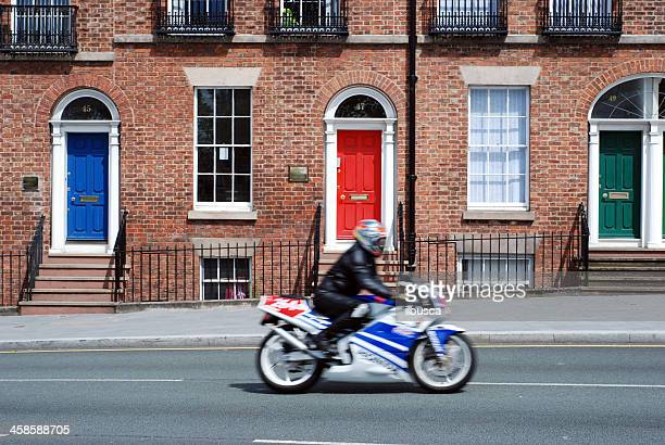 biker driving in front of typical british houses, liverpool - georgian style stock pictures, royalty-free photos & images