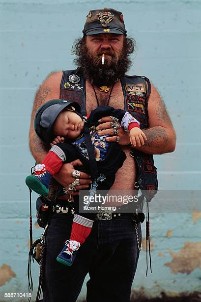 Biker Father Holding Sleeping Son
