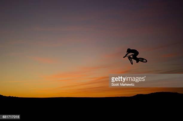 Biker freestyle mountain biking in Page, Arizona