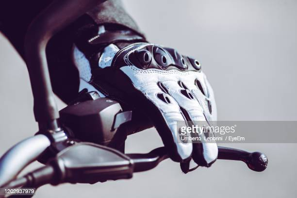 biker hand with protective glove in action riding on the road - sports glove stock pictures, royalty-free photos & images