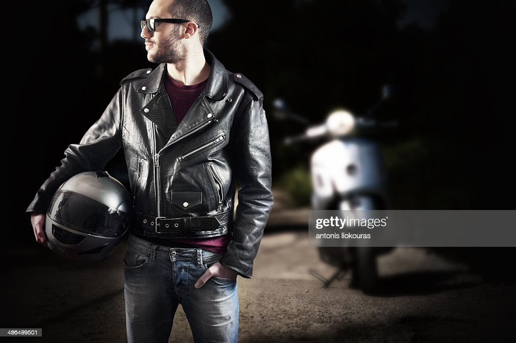 Biker in leather jacket and sunglasses : Stock Photo