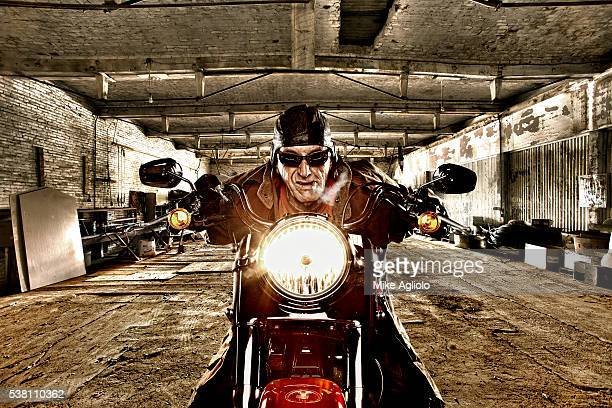 biker in warehouse - mike agliolo stock pictures, royalty-free photos & images