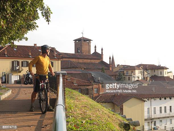 Biker looks over historic town centre from walkway