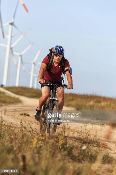 Biker moving down on hillock