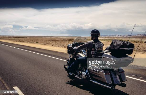 biker on a state hiway in utah - motorcycle biker stock pictures, royalty-free photos & images