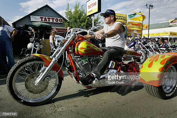 Biker on a trike rides through downtown Sturgis during the start of the annual Sturgis Motorcycle Rally August 4 2003 in Sturgis South Dakota The...