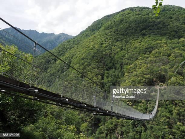 Biker On Carasc Suspension Bridge, Canton of Ticino