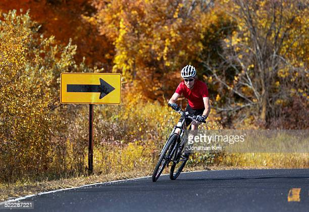biker on rural road in wisconsin - vilas_county,_wisconsin stock pictures, royalty-free photos & images