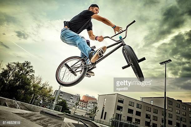 bmx biker - stunt stock photos and pictures