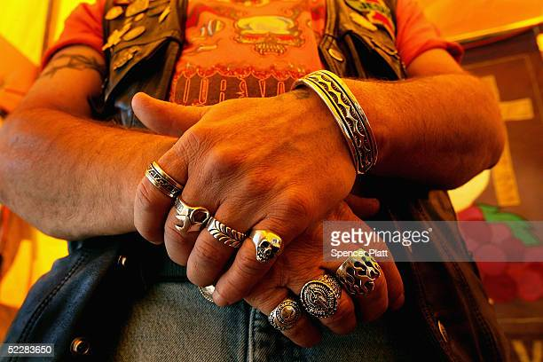 A biker prays during mass given by Christian Riders Ministry at Bike Week March 6 2005 in Daytona Beach Florida The nonprofit group seeks to share...