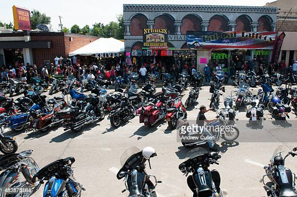 A biker rides downtown on the first day of the annual Sturgis Motorcycle Rally August 3 2015 in Sturgis South Dakota This year marks the seventyfifth...