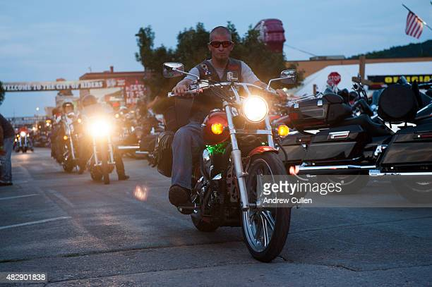 A biker rides downtown on the first day of the annual Sturgis Motorcycle Rally August 3 2015 in Sturgis South Dakota This year marks the 75th...