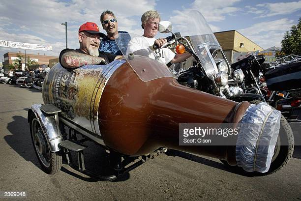 Biker rides his motorcycle with a sidecar shaped like a beer bottle through downtown Sturgis during the start of the annual Sturgis Motorcycle Rally...