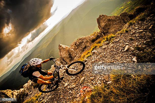 Biker Riding on a Mountain Trail