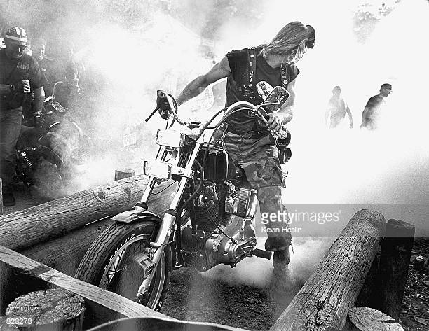 A biker spins his back tire to cause smoke and an intensely foul rubber smell in the ''Burnout Pit March 5 1999 behind the Crazy Horse Saloon during...