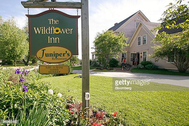 A biker talks to a guest outside the Wildflower Inn on Darling Hill Road which offers direct access to the Kingdom Trails in East Burke Vermont US on...
