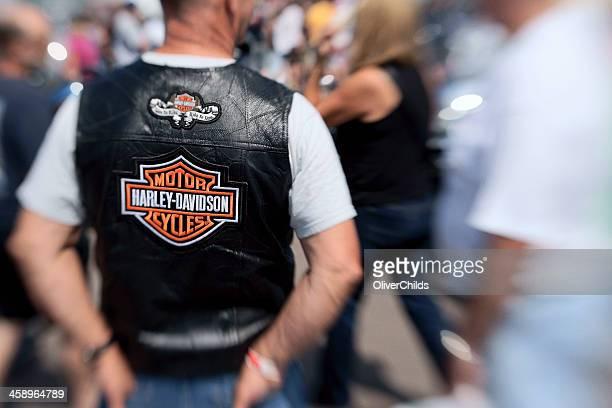 Biker wearing a Harley Davidson vest.