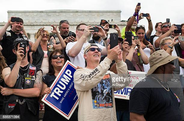 STATES MAY 29 Bikers and supporters cheer as Republican presidential candidate Donald Trump speaks on the National Mall during the Rolling Thunder...