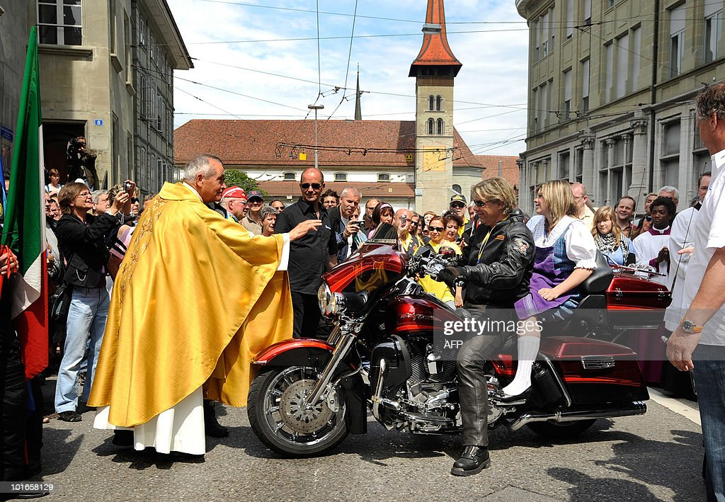 Bikers are blessed by the Cathedral of St. Nicolas during a mass on June 6, 2010 in Fribourg, western part of Switzerland. The 19th rally of the Madonna of the Centaurus gathered bikers from all around, a few of them even drove inside the church with their gear to perpetuate the wish of the Madonna of the Centaurus founder, Italian Marco Re who had the idea in 1943 of spreading goodwill through the gathering of bikers. In 1947 the Vatican proclaimed the Virgin of the Basilica of Castellazzo the patron saint of bikers.