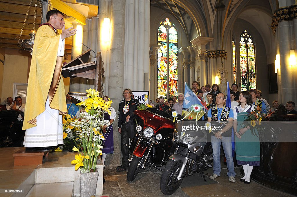 Bikers are blessed in the Cathedral of St. Nicolas during a mass on June 6, 2010 in Fribourg, western part of Switzerland. The 19th rally of the Madonna of the Centaurus gathered bikers from all around, a few of them even drove inside the church with their gear to perpetuate the wish of the Madonna of the Centaurus founder, Italian Marco Re who had the idea in 1943 of spreading goodwill through the gathering of bikers. In 1947 the Vatican proclaimed the Virgin of the Basilica of Castellazzo the patron saint of bikers.