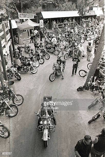 Bikers arrive at the Crazy Horse Saloon During Bike Week March 7 2000 near Daytona Beach Florida The bar is a popular spot with bikers where they can...
